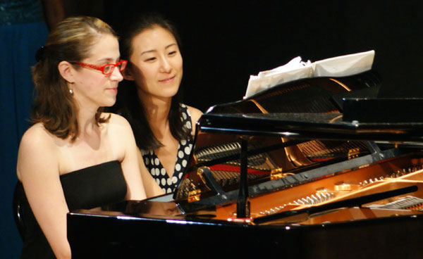 Pianists Melony Maness and Soojeong Joo try out the piano before the big concert in Teatro Bramante - 2008.