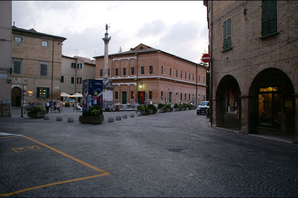The main square of Urbania with the Teatro Bramante and the column with Saint Christopher.