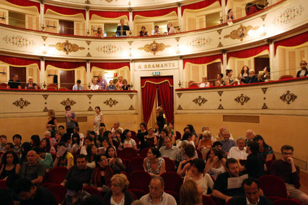 "The audience gathers in anticipation of the ""Si parla, si canta 2011"" concert at Urbania's charming Teatro Bramante."